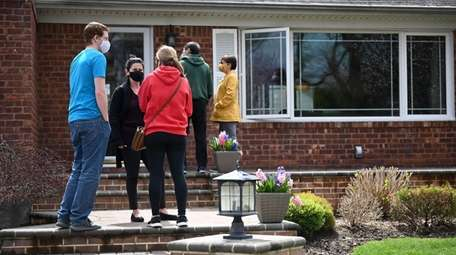 Prospective buyers line up outside an open house