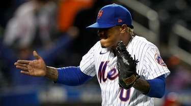 Marcus Stroman of the Mets reacts after the