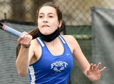 Ellie Ross of Port Washington returns a serve