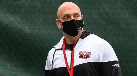 Syosset head coach, Shai Fisher, closely monitors play