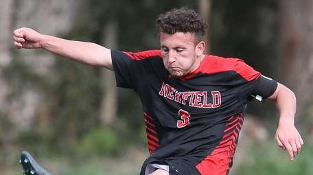 Newfield's Lorenzo Selini takes a shot in the