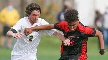 Newfield's Brendan Maguire (14) and Ward Melville's Zach