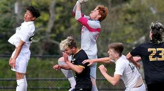 Commack keeper Dario Maricevic punches away the corner