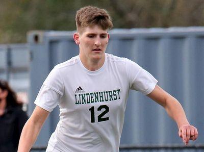 Lindenhurst defender Adam Lesniewski moves the ball out