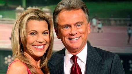 """""""Wheel of Fortune"""" host Pat Sajak, right, and"""