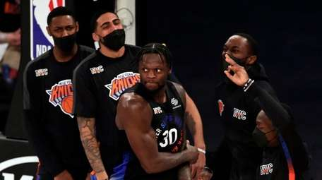 Knicks forward Julius Randle reacts with teammates after