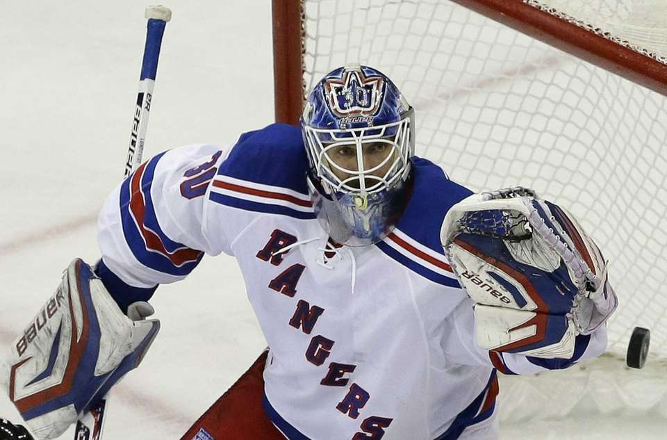 Rangers goalie Henrik Lundqvist reaches for the puck
