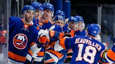 Islanders' Anthony Beauvillier (18) celebrates with teammates after