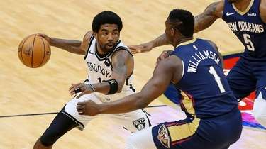 Kyrie Irving #11 of the Nets drives against