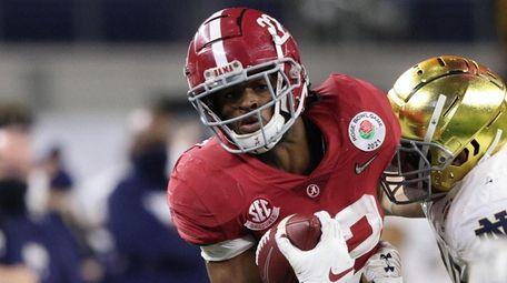 Alabama running back Najee Harris carries the football