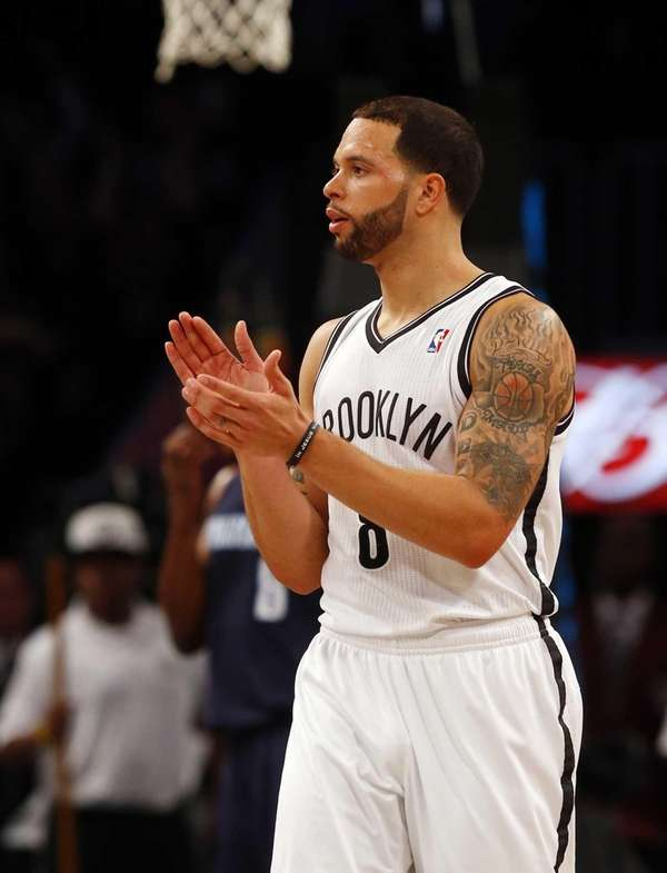 Deron Williams celebrates a basket during a game