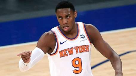 The Knicks' RJ Barrett reacts after scoring during
