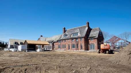 A historic home under construction on three acres