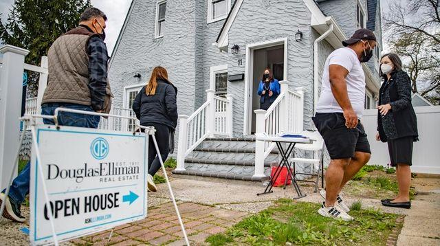 Real estate agents Rosa Arrigo, at door, and