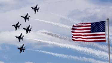 The Air Force Thunderbirds soar above Jones Beach