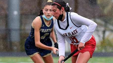 Miller Place midfielder Taylor Giugliano stick handles through