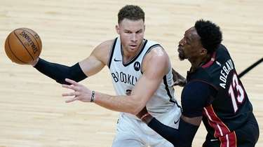Nets forward Blake Griffin, left, looks for an
