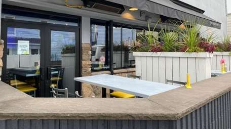 Sidewalk dining at The Ugly Duckling in Long