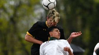 Brett Anderson of Commack and Tony Vigil of