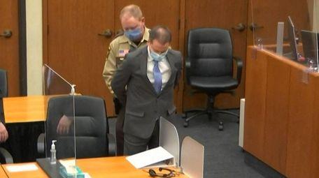 Former Minneapolis police Officer Derek Chauvin is handcuffed