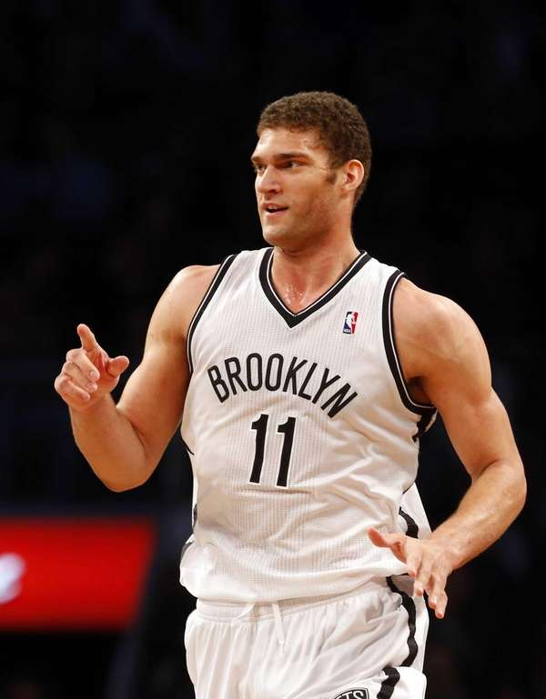 Brook Lopez of the Nets celebrates a basket