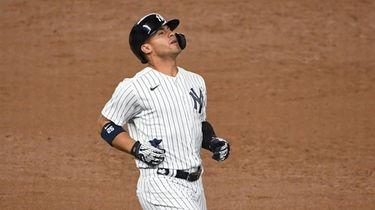 Yankees shortstop Gleyber Torres reacts after he grounds