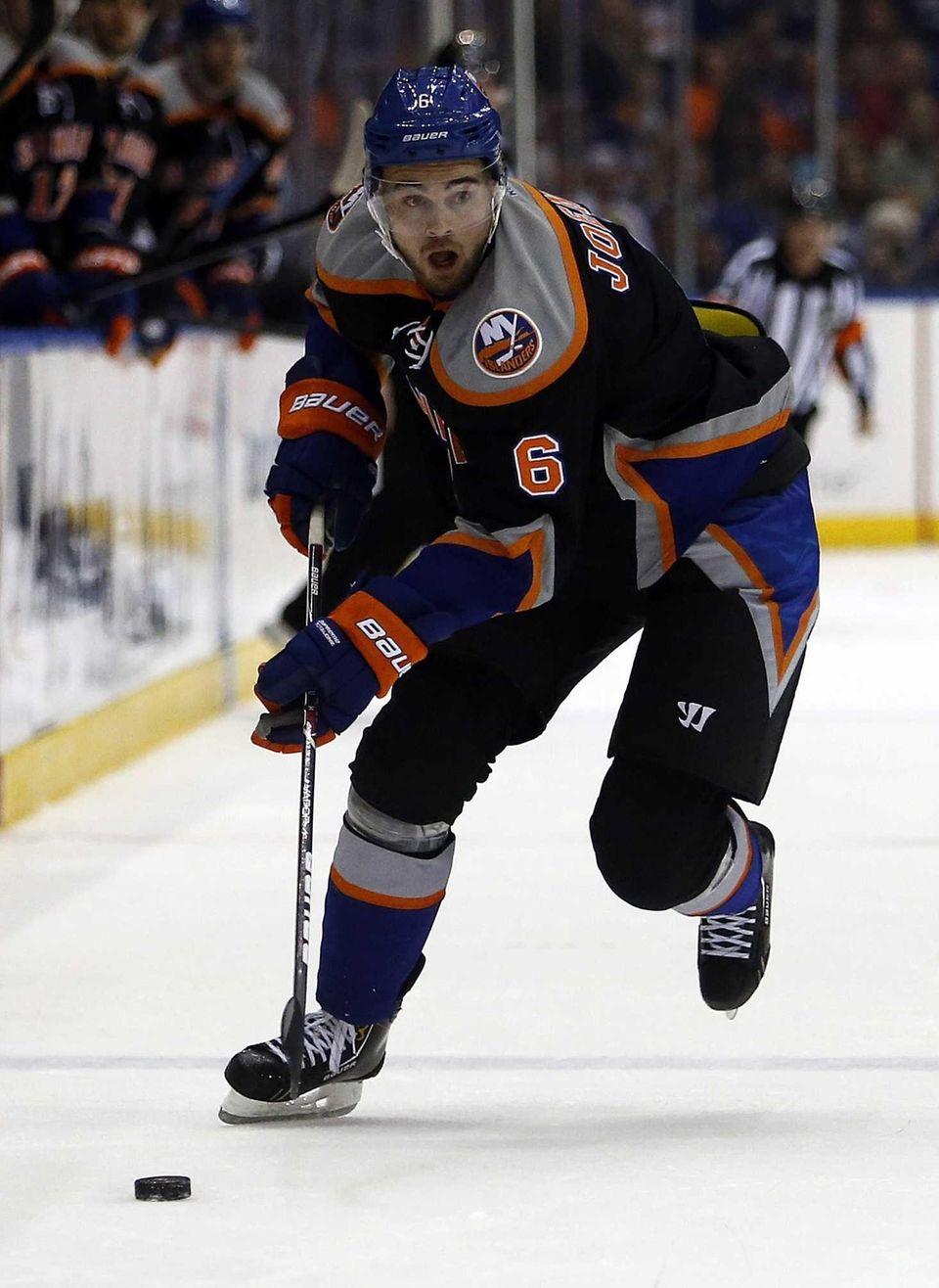 Islanders left wing Jesse Joensuu controls the puck
