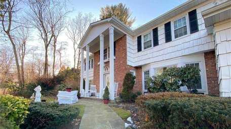 Priced at $1,150,000, this five-bedroom, 4½-bathroom Colonial on