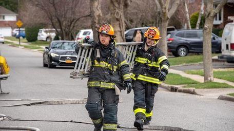 Probationary Syosset firefighter Joshua Lee, left, never aspired
