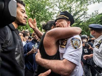 A protester and NYPD Chief of Department Terence