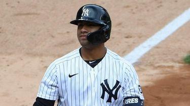 Yankees shortstop Gleyber Torres reacts while at bat
