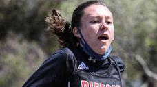 Penelope Greene of Pierson crosses the finish line