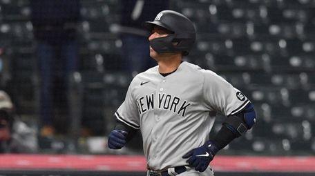 Kyle Higashioka #66 of the Yankees rounds the