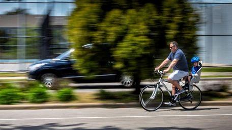 People run, walk and bike through John J.