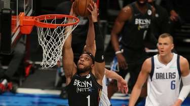 Nets guard Bruce Brown (1) is fouled by