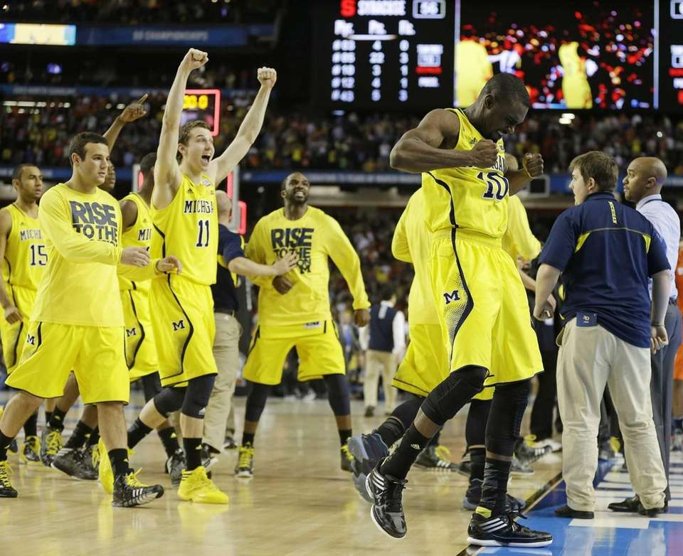 Michigan players react after the second half of