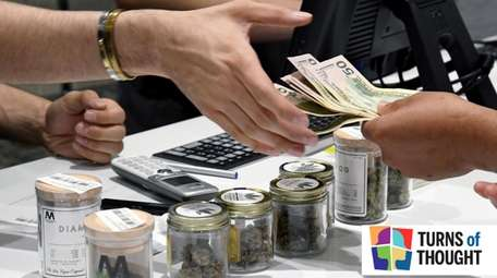 A customer pays for recreational marijuana products at