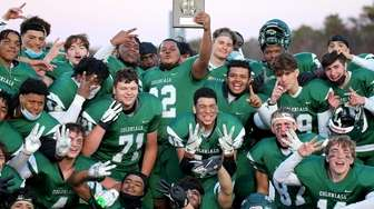 Floyd celebrates its 28-21 overtime win over Whitman,
