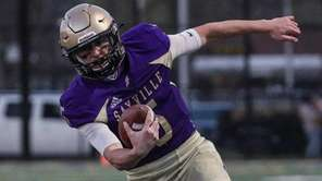 Sayville quarterback Jack Cheshire runs the sidelines during
