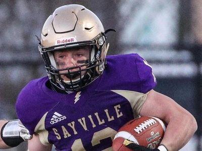 Sayville's Mack Murtha (12) avoids Rob Moreland of