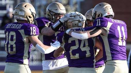 Sayville's Tom Cea is congratulated by teammates after