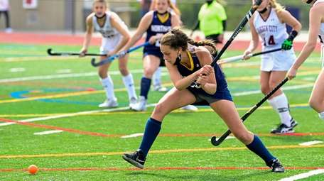 Sophia Bica #5 of Northport hits the ball