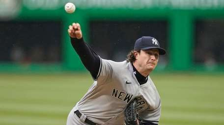 Yankees starting pitcher Gerrit Cole delivers in the