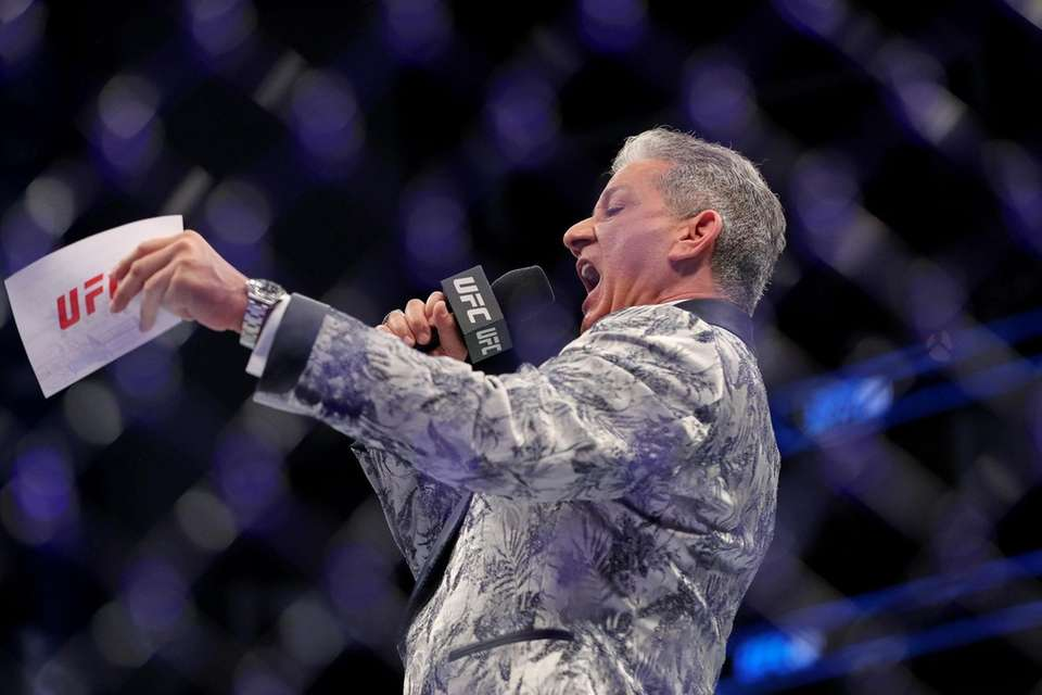 Octagon announcer Bruce Buffer announces fighters during UFC