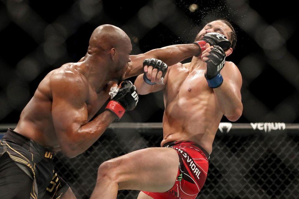 Kamaru Usman of Nigeria punches Jorge Masvidal of