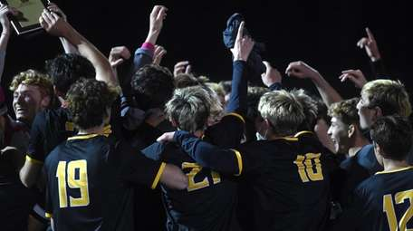 Commack teammates celebrate after their 2-1 win over