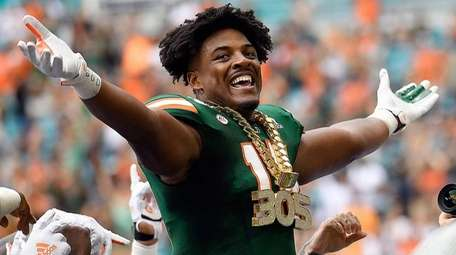 Miami defensive end Gregory Rousseau wears the turnover