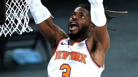 The Knicks' Nerlens Noel goes to the basket