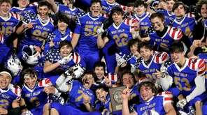 West Islip celebrates its victory over Bellport in