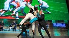 Christian Wilkins of Clemson celebrates with NFL Commissioner